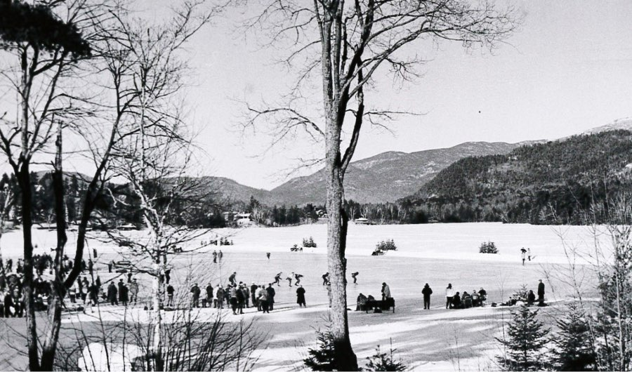 Skaters race around the ice on Mirror Lake in Lake Placid