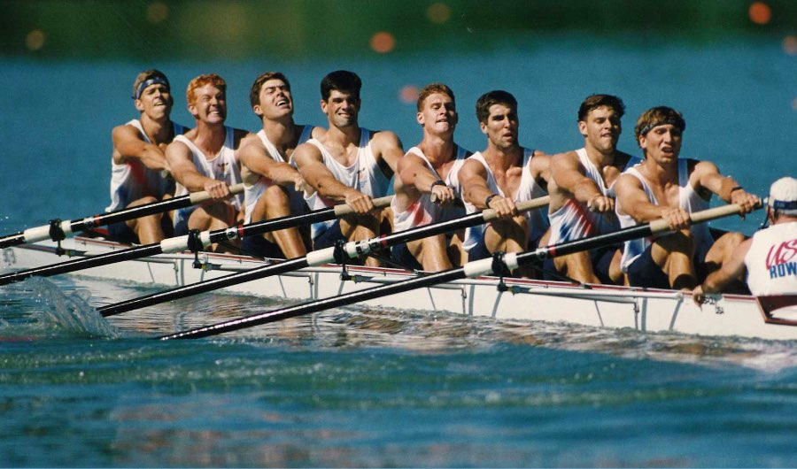 A team of eight rowers pull together during a race at the 1993 Summer World University Games in Buffalo, New York