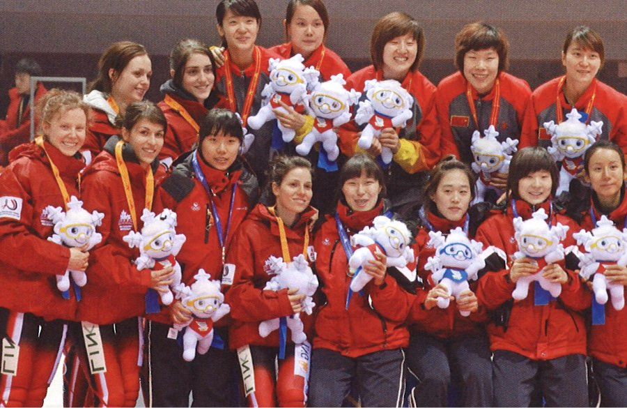 Medal winners of the women's short track relay stand on the podium at the 2009 Winter World University Games in Harbin, China