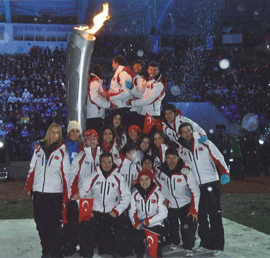 Members of the host team of the 2011 Winter World Univesity Games in Erzurum, Turkey pose by the FISU flame