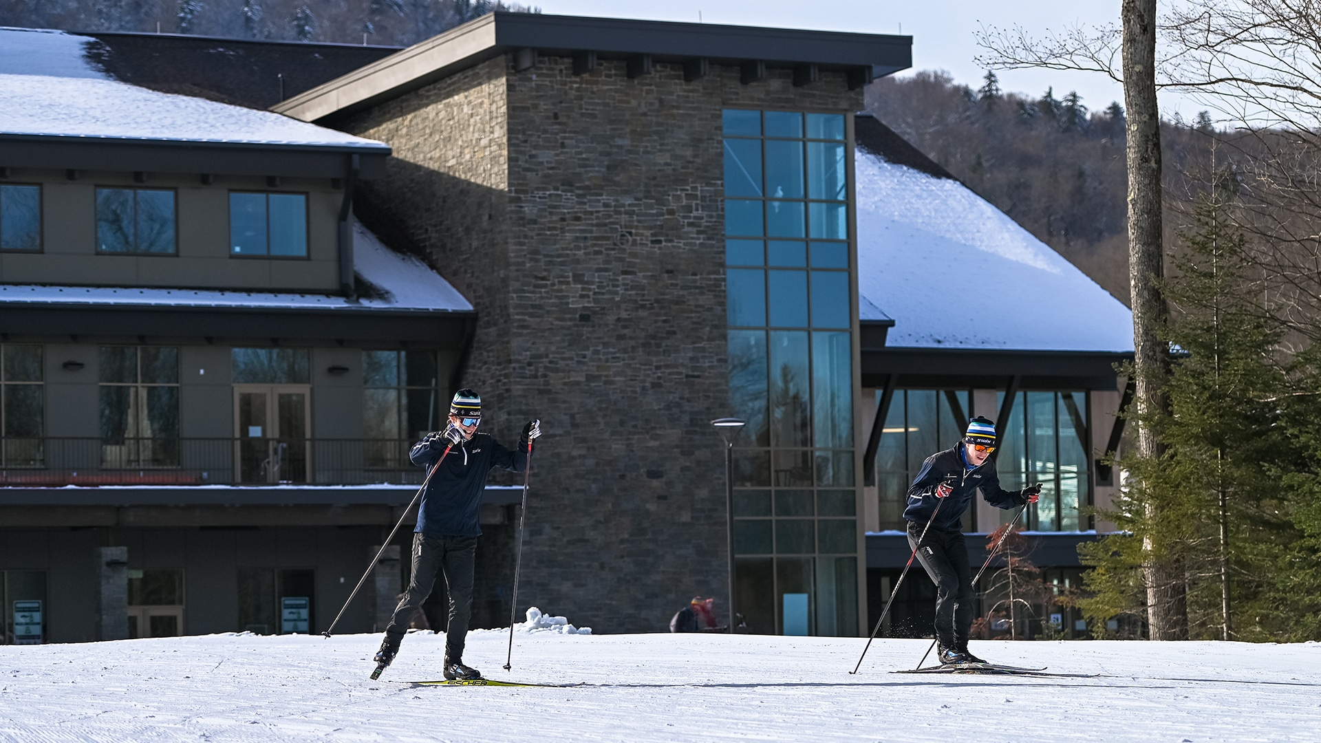 Skiers outside the lodge at the Mount Van Hoevenberg nordic skiing center
