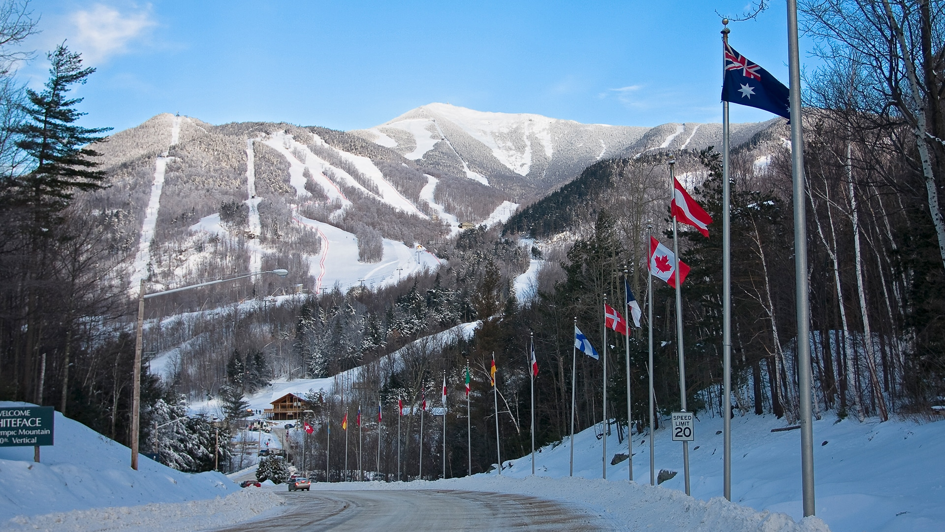 A series of flags of different nations line the road leading to Whiteface Mountain ski resort